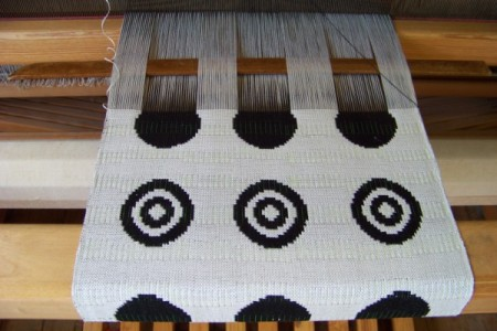 Doubleweave circles partly woven.
