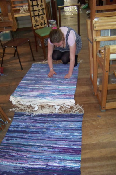Emily and her 2 rag rugs just off the loom.