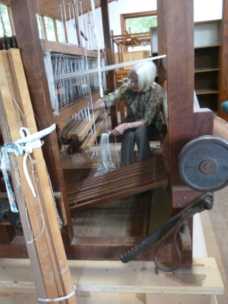 Maureen fixing the loom she's weaviong a floor rug on.