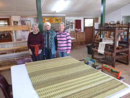 Maureen (centre) shows off her finished rug.