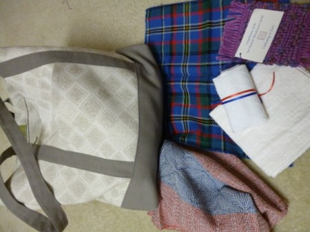 Conference bag with handwoven napkins, lunch bag, covered book.
